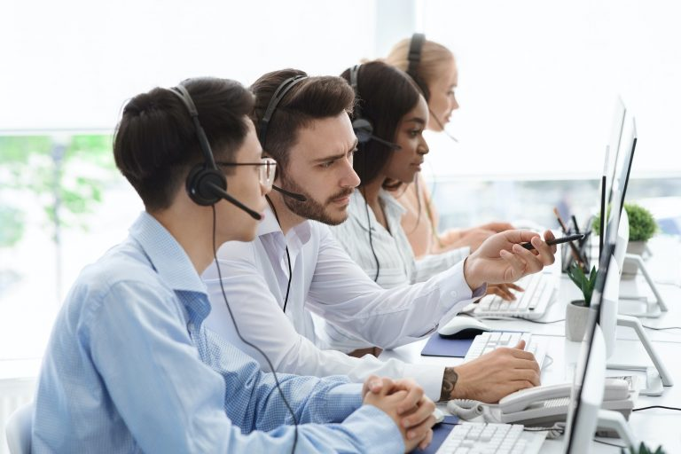 Technical support operators solving problem with client communication in call centre